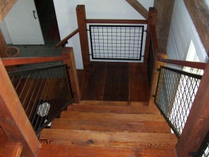 planks used as a stairway in renovated timber frame