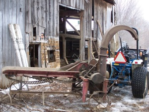 Antique farm equipment from post and beam frame