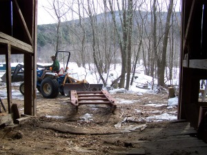 Removing equipment from old barn for sale in new england
