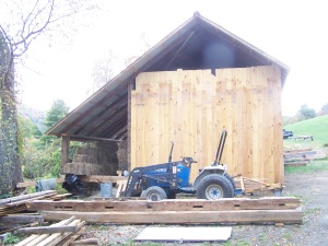 Reclaimed wood siding on timber frame barn