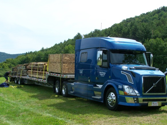 Vintage timber frame on tractor trailer
