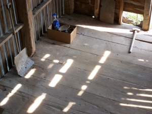 Wide pine floor in corn crib
