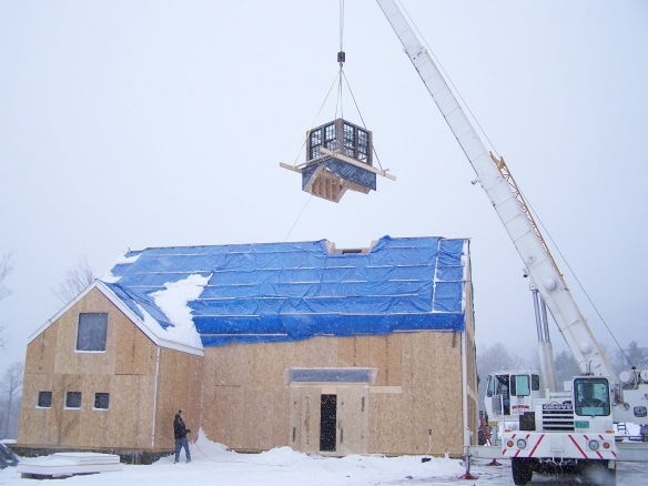 setting a cupola on a barn frame in winter