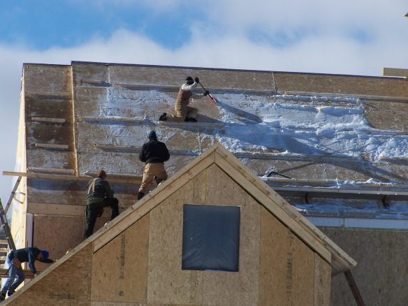 removing snow from vermont timber frame home