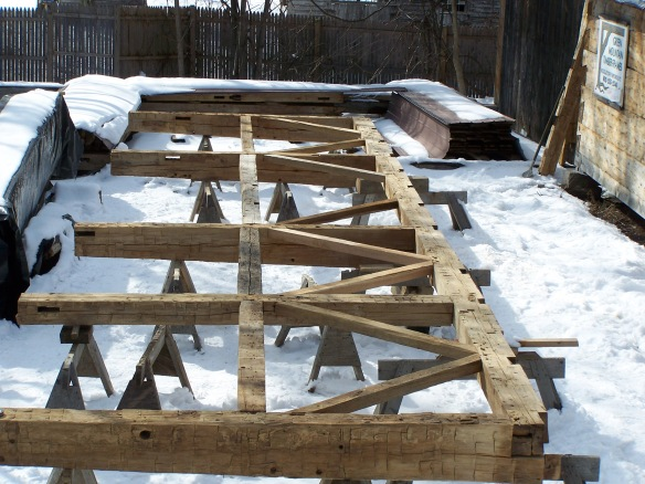 Timber frame restoration in Vermont winter