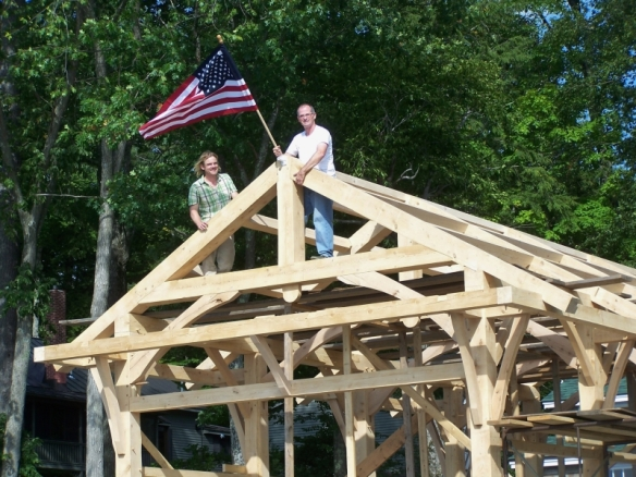 Flag Raising on boat house_Green Mountain Timber Frames_Luke Larson