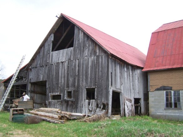 historic wooden barn with red roof