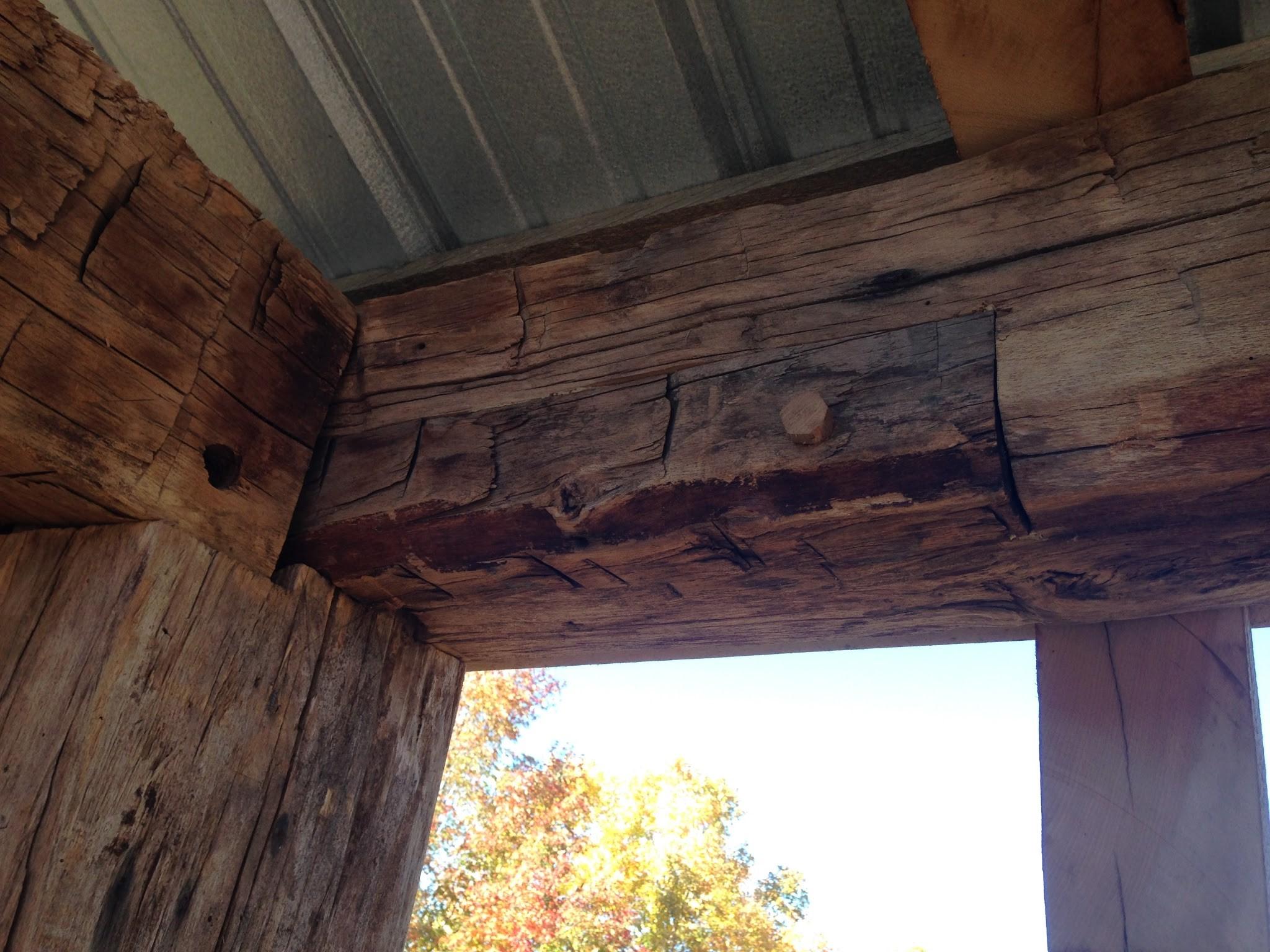 repaired wooden beam_restored timber frame_green mountain timber frame_larson farm