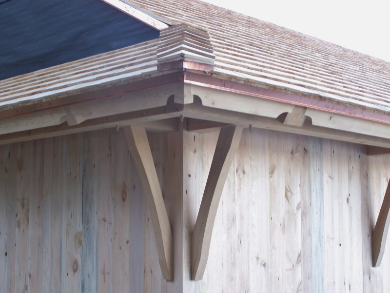 Corner details of boat house completed with siding_Green Mountain Timber Frames_Luke Larson