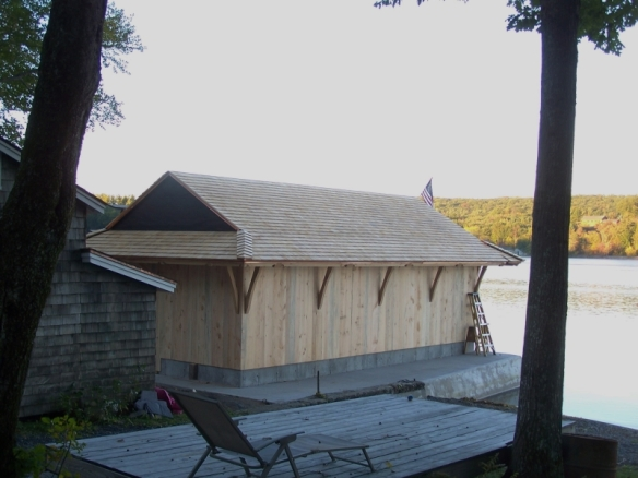 Custom Boat House_Boat house completed with siding_Green Mountain Timber Frames_Luke Larson