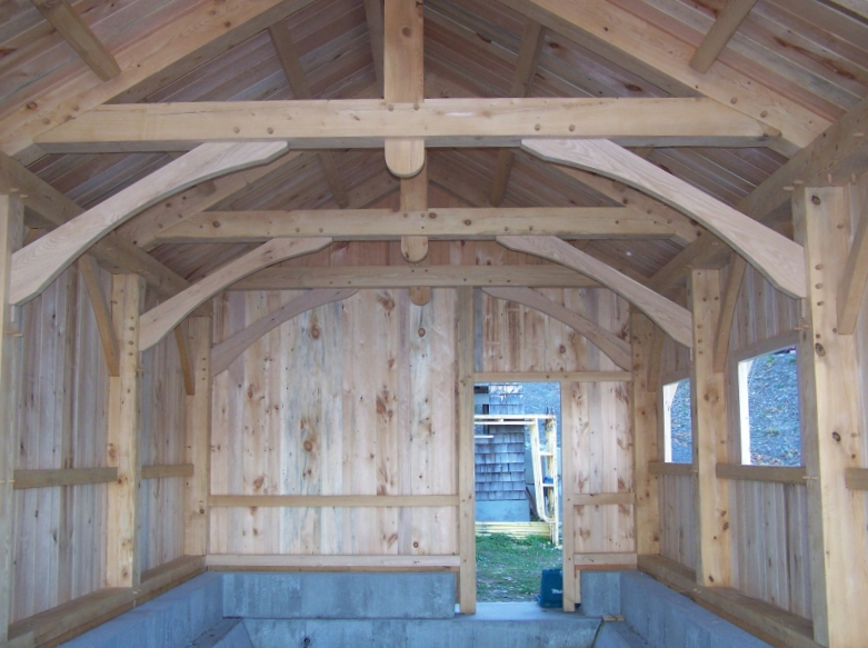 Interior view of custom boat house_Boat house completed with siding_Green Mountain Timber Frames_Luke Larson