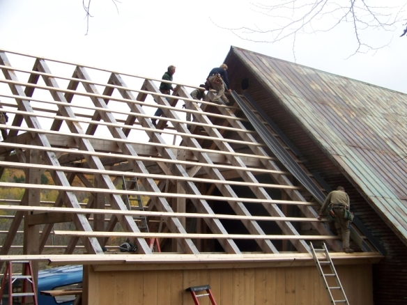 Working on roof of historic timber frame_green mountain timber frames_vermont