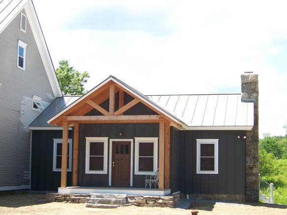 Exterior of Cavendish Barn Frame with front entry_Green Mountain Timber Frames