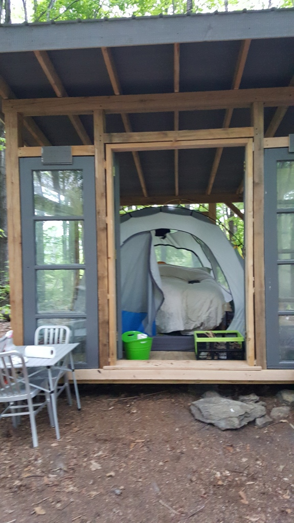 Glamping in a timber frame glass house