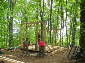 Raising timber beams of glass house