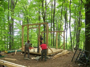 Raising timber beams of glass house