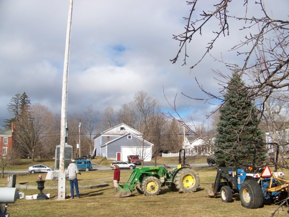 Lifting flag pole with tractors_Green Mountain Timber Frames_Vermont