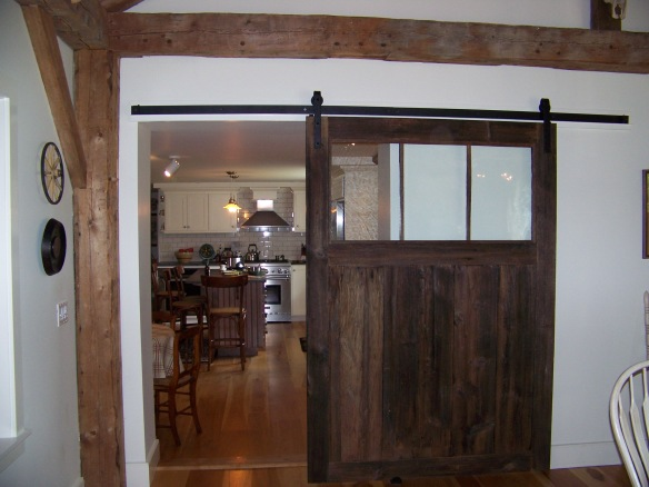 Barn door entryway to new england great room_green mountain timber frames.JPG