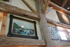 Detail of wall and exposed wooden beams_Steven Kellogg Timber Frame Home