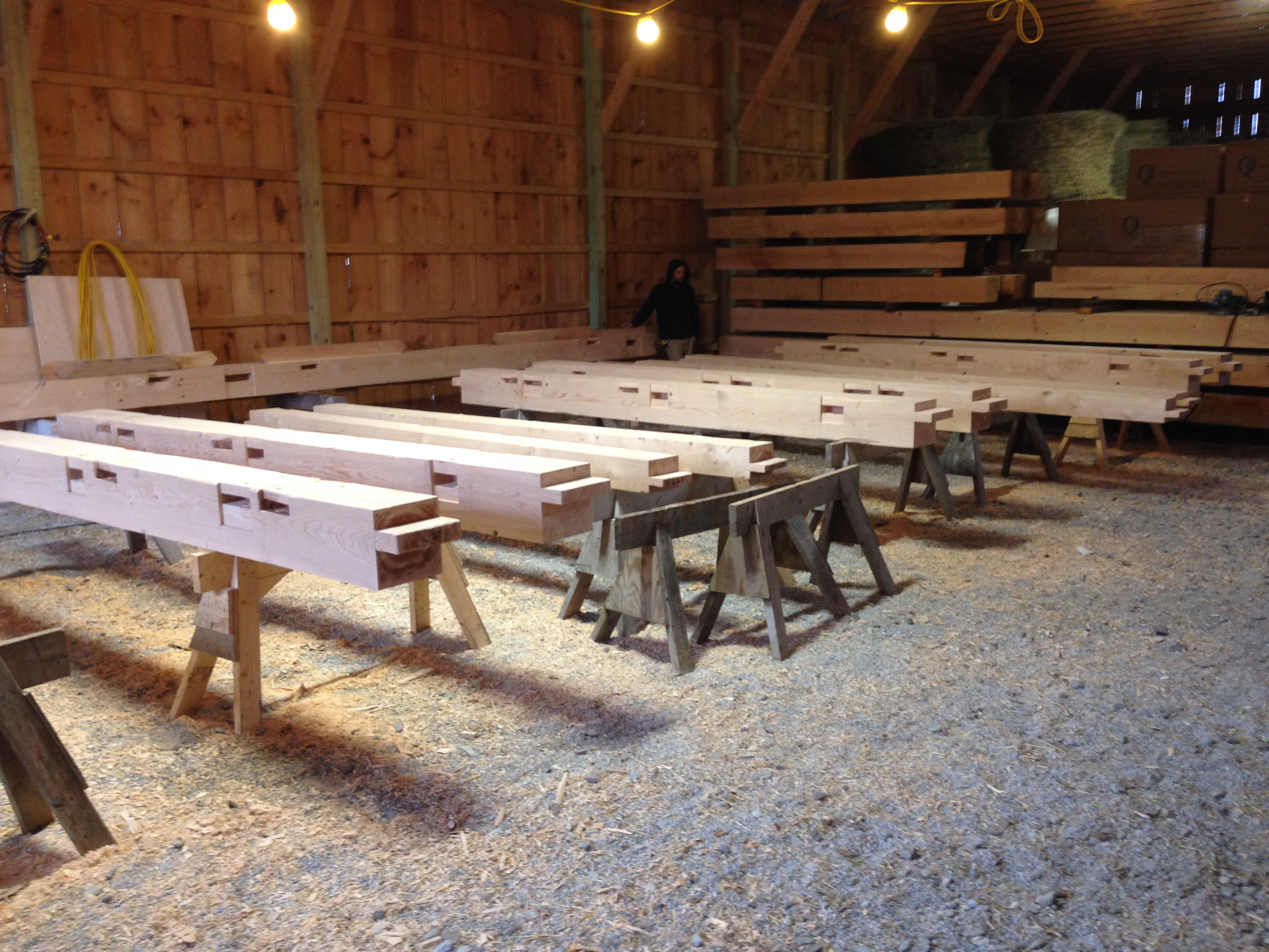 Post joinery is cut for timber frame