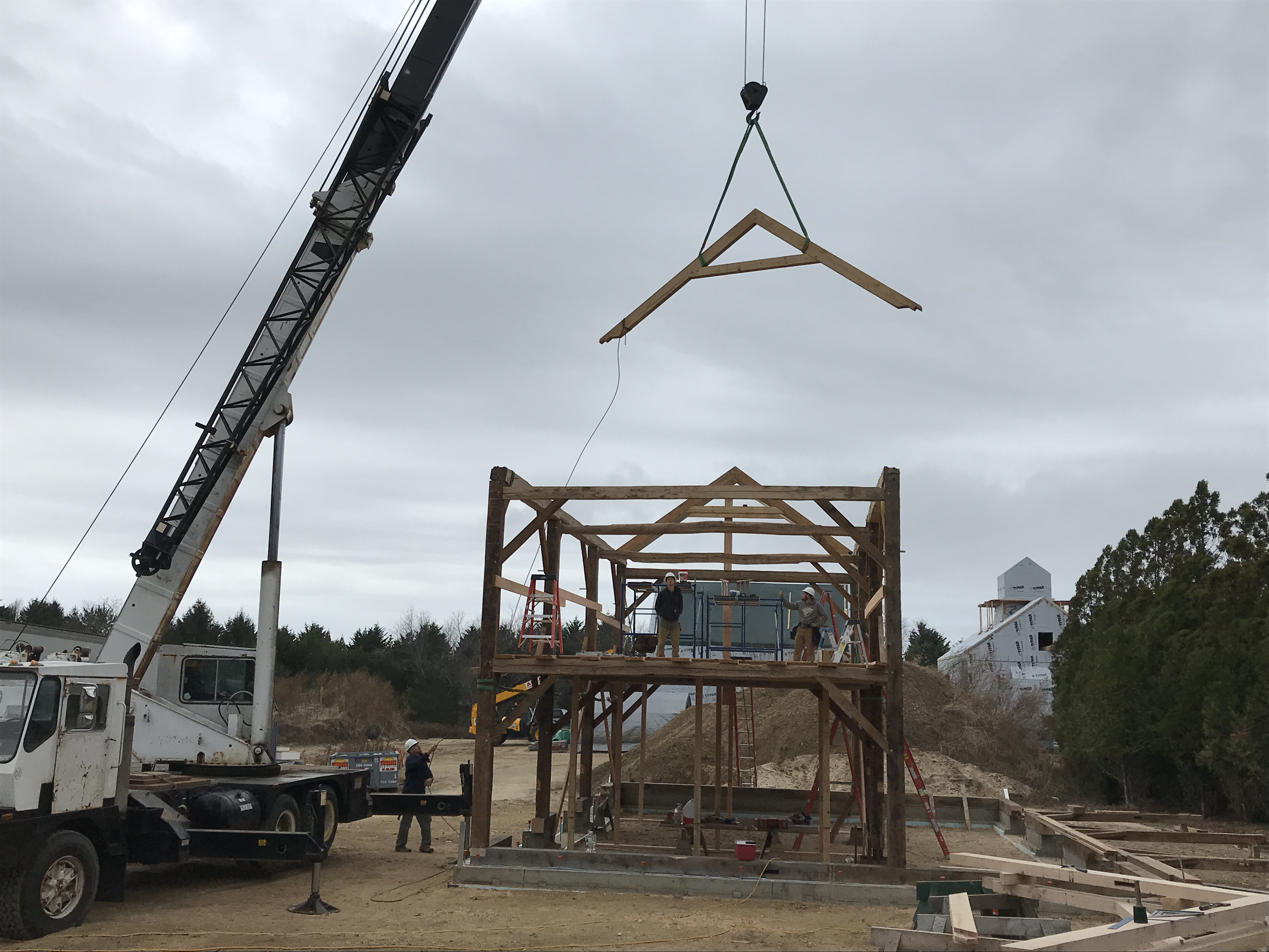 Rafter trusses are flown into place__Green Mountain Timber Frames