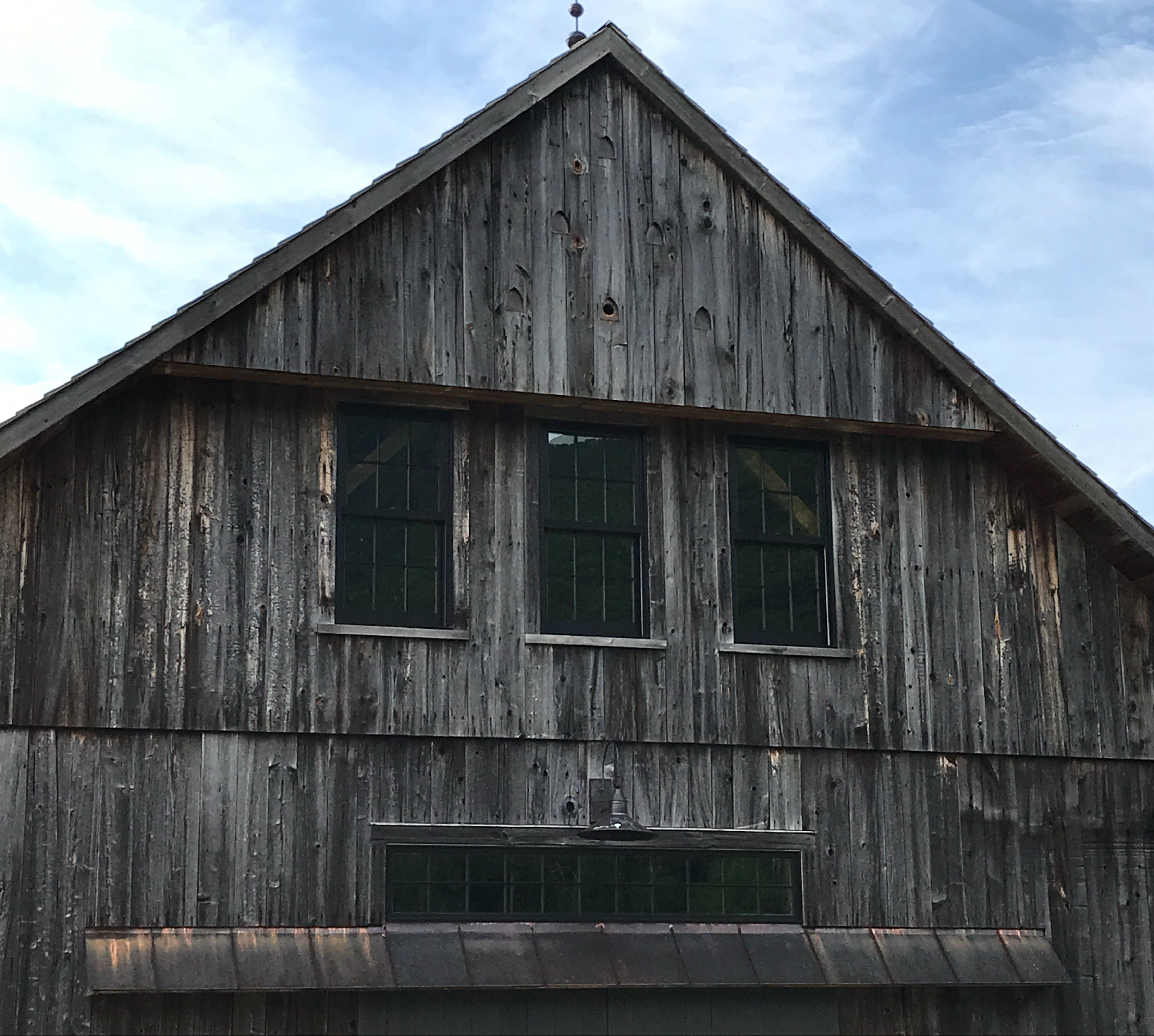 timber frame barn with barn swallows