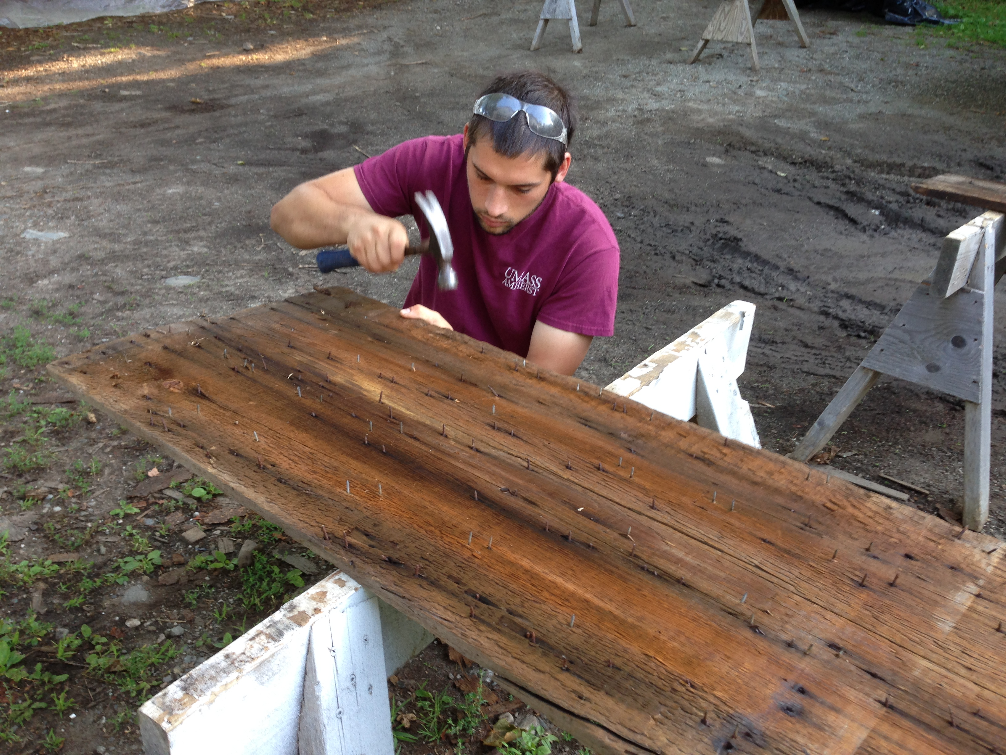 Removing nails to restore wooden timbers