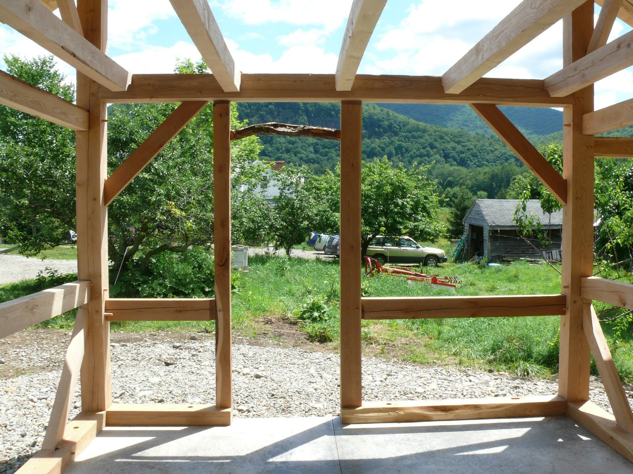 Plumb tree door header in timber frame sugar house green mountain timber frames