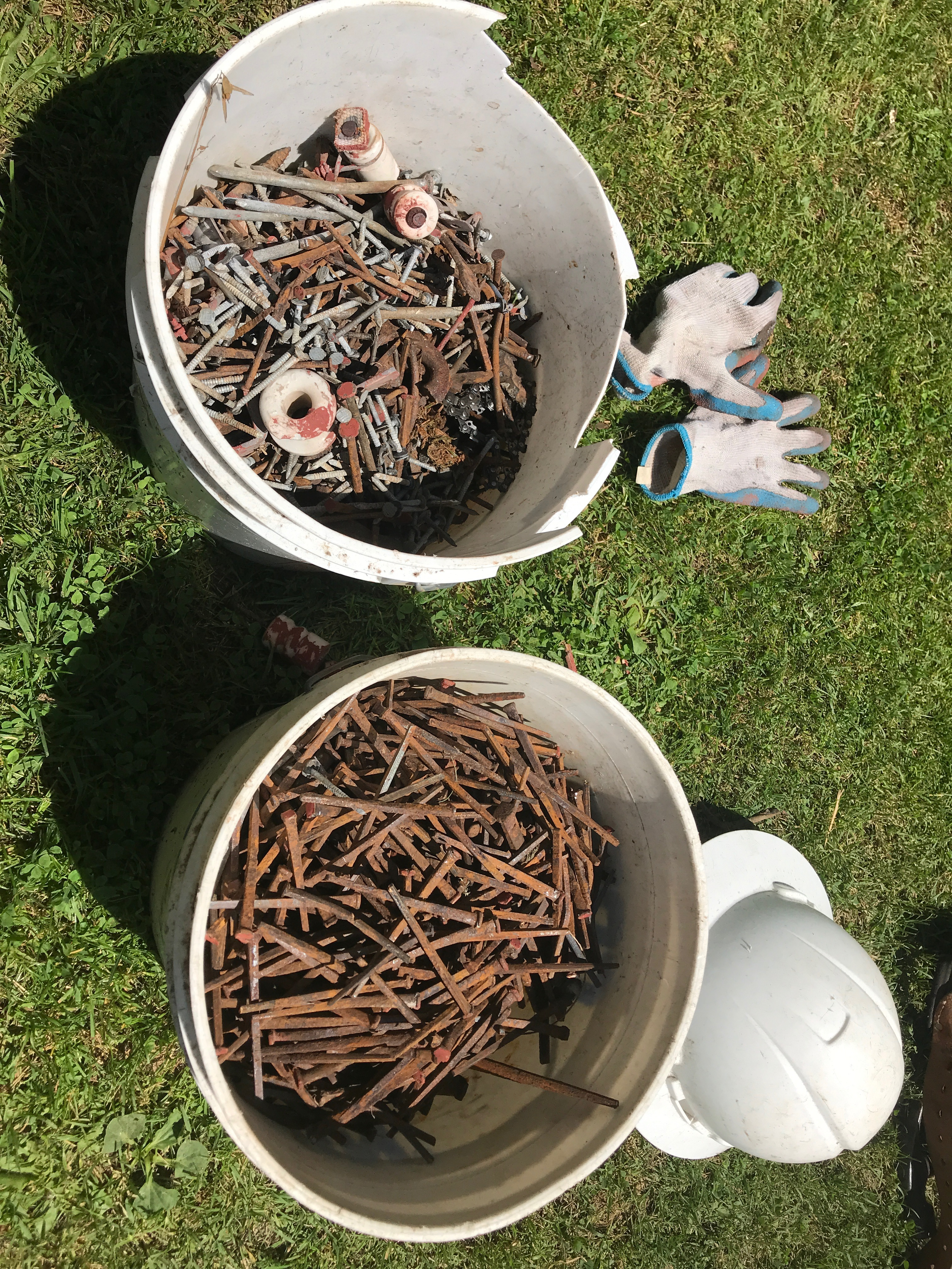 buckets of salvaged nails from timber frame projects