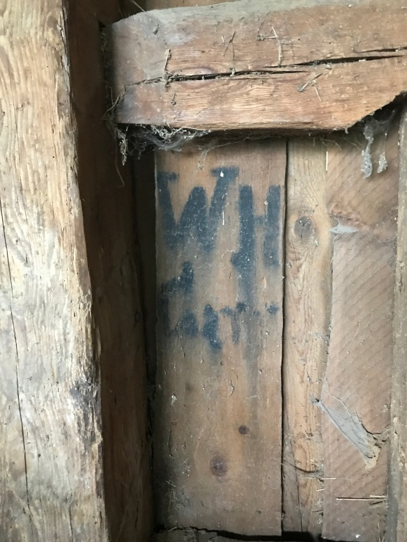 graffiti or initials in gunstock barn restored by green mountain