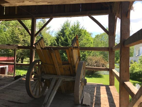 horse drawn dump wagon in restored barn frame