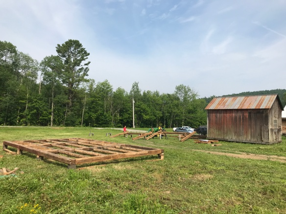 preparing for barn raising of restored vermont farm house