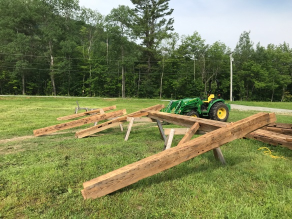 raising reclaimed wood from timber frame barn home in Vermont