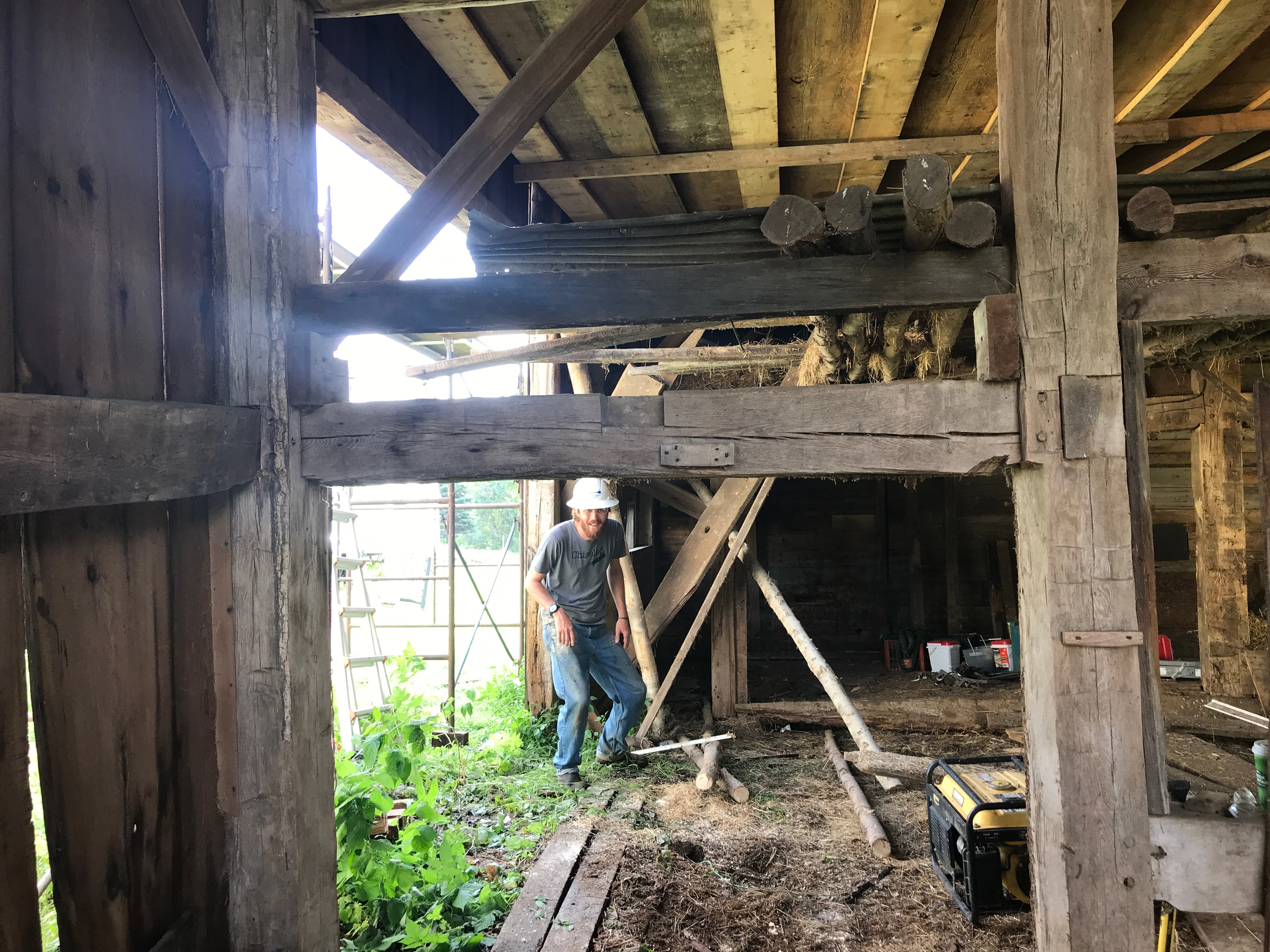 Interior taking down Galway Barn Green Mountain Timber Frames